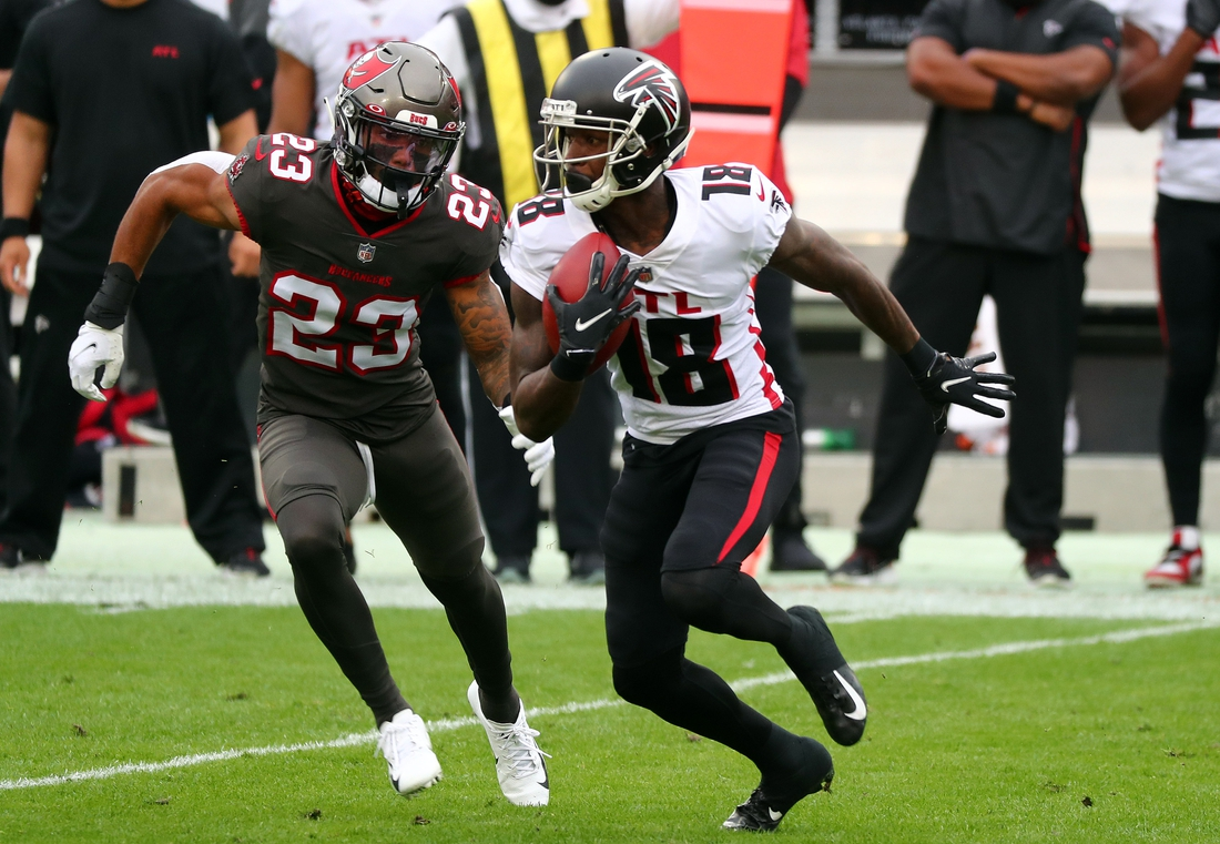 Jan 3, 2021; Tampa, Florida, USA;Atlanta Falcons wide receiver Calvin Ridley (18) runs with the ball as Tampa Bay Buccaneers cornerback Sean Murphy-Bunting (23) defends  during the first quarter at Raymond James Stadium. Mandatory Credit: Kim Klement-USA TODAY Sports