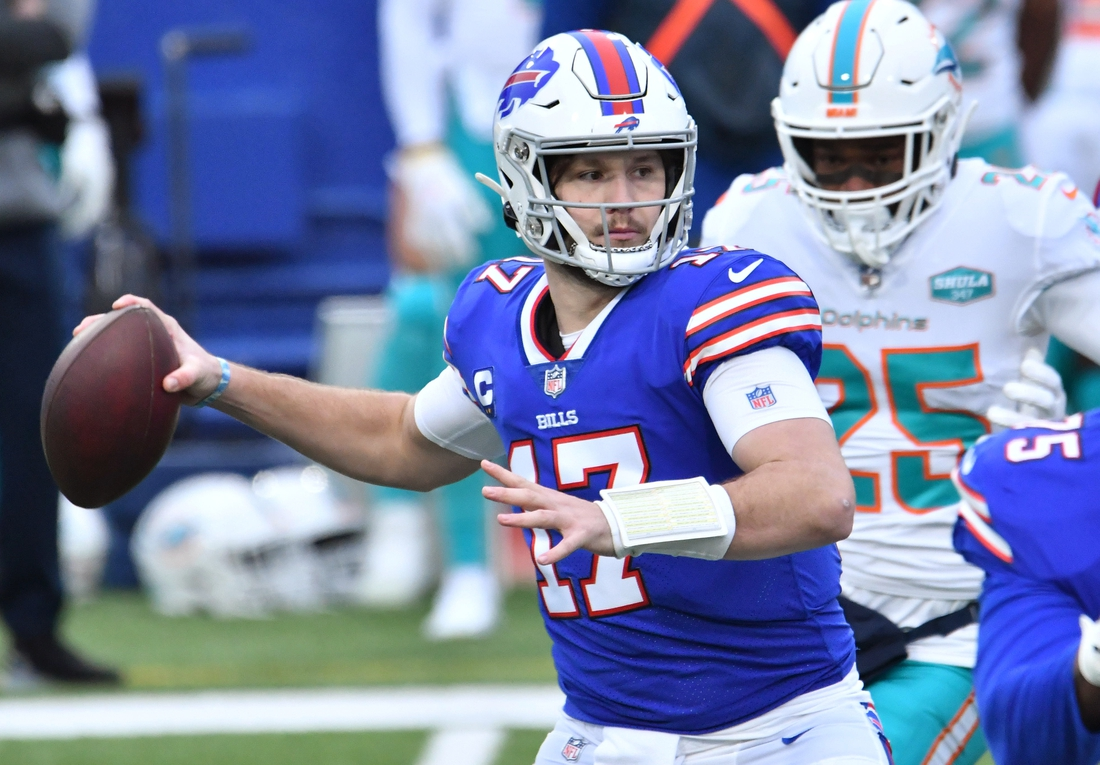 Jan 3, 2021; Orchard Park, New York, USA; Buffalo Bills quarterback Josh Allen (17) throws a pass against the Miami Dolphins in the first quarter at Bills Stadium. Mandatory Credit: Mark Konezny-USA TODAY Sports