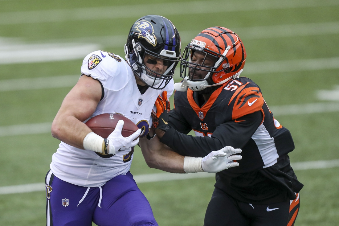 Jan 3, 2021; Cincinnati, Ohio, USA; Cincinnati Bengals linebacker Germaine Pratt (57) pushes Baltimore Ravens tight end Mark Andrews (89) out of bounds in the first half at Paul Brown Stadium. Mandatory Credit: Katie Stratman-USA TODAY Sports