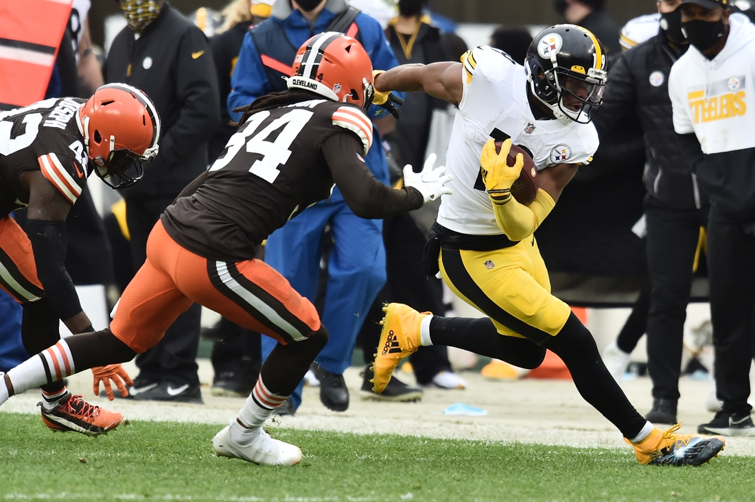 Jan 3, 2021; Cleveland, Ohio, USA; Cleveland Browns cornerback Robert Jackson (34) knocks Pittsburgh Steelers wide receiver JuJu Smith-Schuster (19) out of bounds during the first half at FirstEnergy Stadium. Mandatory Credit: Ken Blaze-USA TODAY Sports
