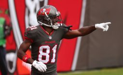 Jan 3, 2021; Tampa, Florida, USA; Tampa Bay Buccaneers wide receiver Antonio Brown (81) celebrates after scoring a touchdown against the Atlanta Falcons during the second quarter at Raymond James Stadium. Mandatory Credit: Kim Klement-USA TODAY Sports