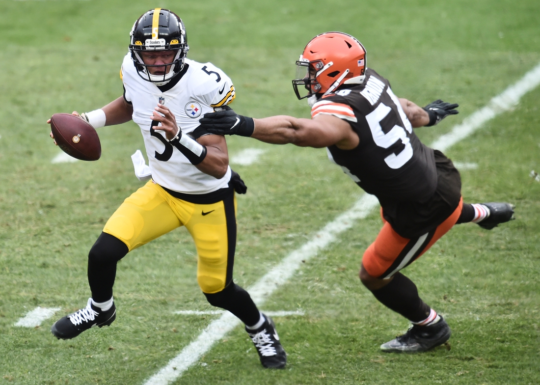 Jan 3, 2021; Cleveland, Ohio, USA; Pittsburgh Steelers quarterback Joshua Dobbs (5) is chased by Cleveland Browns defensive end Olivier Vernon (54) during the second half at FirstEnergy Stadium. Mandatory Credit: Ken Blaze-USA TODAY Sports