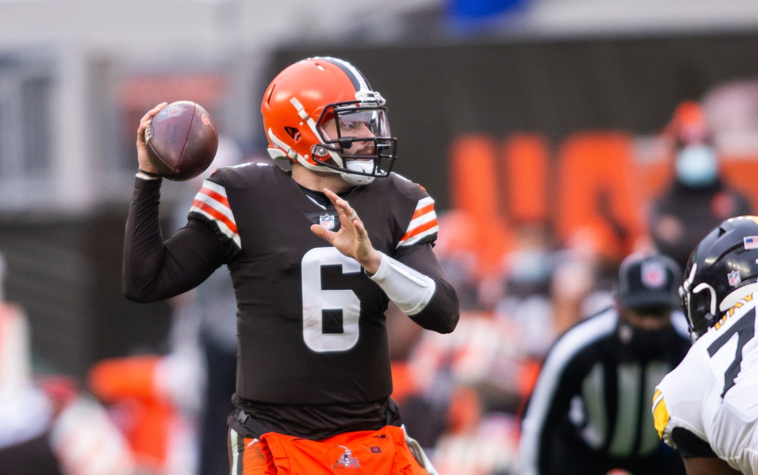 Jan 3, 2021; Cleveland, Ohio, USA; Cleveland Browns quarterback Baker Mayfield (6) looks for an available receiver against the Pittsburgh Steelers during the third quarter at FirstEnergy Stadium. Mandatory Credit: Scott Galvin-USA TODAY Sports