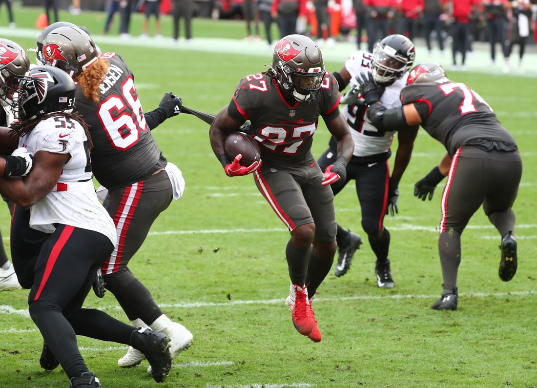 Jan 3, 2021; Tampa, Florida, USA; Tampa Bay Buccaneers running back Ronald Jones (27) runs the ball in for a touchdown  against the Atlanta Falcons during the second half at Raymond James Stadium. Mandatory Credit: Kim Klement-USA TODAY Sports