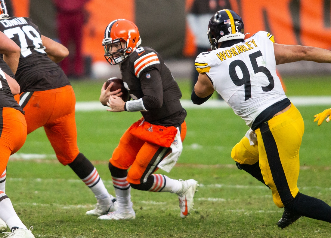 Jan 3, 2021; Cleveland, Ohio, USA; Cleveland Browns quarterback Baker Mayfield (6) runs the ball as Pittsburgh Steelers nose tackle Chris Wormley (95) moves in for the tackle during the fourth quarter at FirstEnergy Stadium. Mandatory Credit: Scott Galvin-USA TODAY Sports