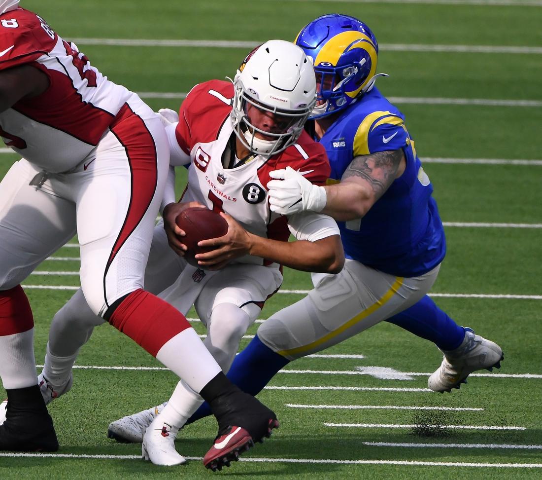 Jan 3, 2021; Inglewood, California, USA; Los Angeles Rams defensive end Morgan Fox (97) sacks Arizona Cardinals quarterback Kyler Murray (1) during the first quarter at SoFi Stadium. Mandatory Credit: Robert Hanashiro-USA TODAY Sports