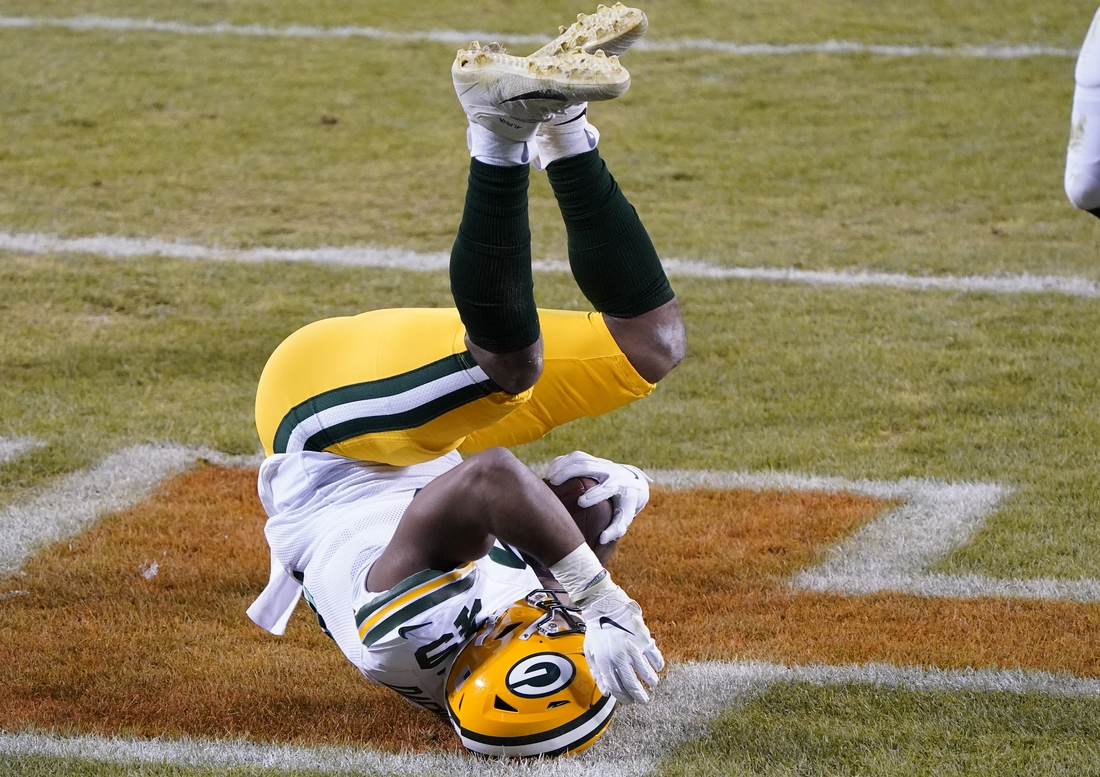 Jan 3, 2021; Chicago, Illinois, USA; Green Bay Packers tight end Dominique Dafney (49) makes a touchdown catch against the Chicago Bears during the second quarter at Soldier Field. Mandatory Credit: Mike Dinovo-USA TODAY Sports