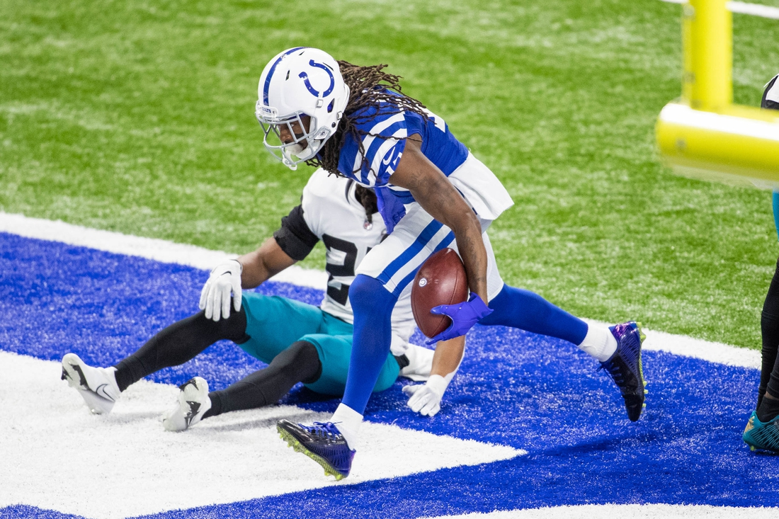 Jan 3, 2021; Indianapolis, Indiana, USA; Indianapolis Colts wide receiver T.Y. Hilton (13) scores a touchdown in the first half against the Jacksonville Jaguars at Lucas Oil Stadium. Mandatory Credit: Trevor Ruszkowski-USA TODAY Sports