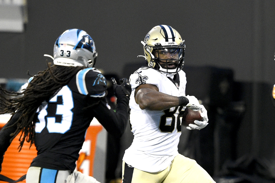 Jan 3, 2021; Charlotte, North Carolina, USA; New Orleans Saints running back Ty Montgomery (88) with the ball as Carolina Panthers free safety Tre Boston (33) defends in the second quarter at Bank of America Stadium. Mandatory Credit: Bob Donnan-USA TODAY Sports