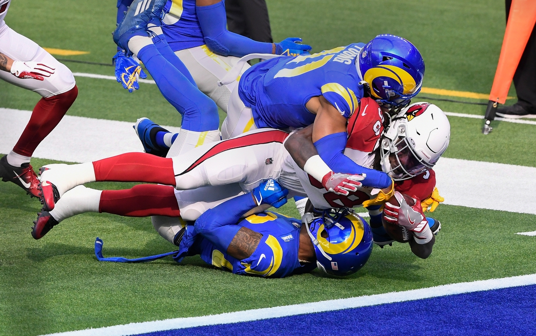 Jan 3, 2021; Inglewood, California, USA; Arizona Cardinals running back Jonathan Ward (38) bulls his way into the end zone to zone a touchdown in the first quarter against the Los Angeles Rams at SoFi Stadium. Mandatory Credit: Robert Hanashiro-USA TODAY Sports