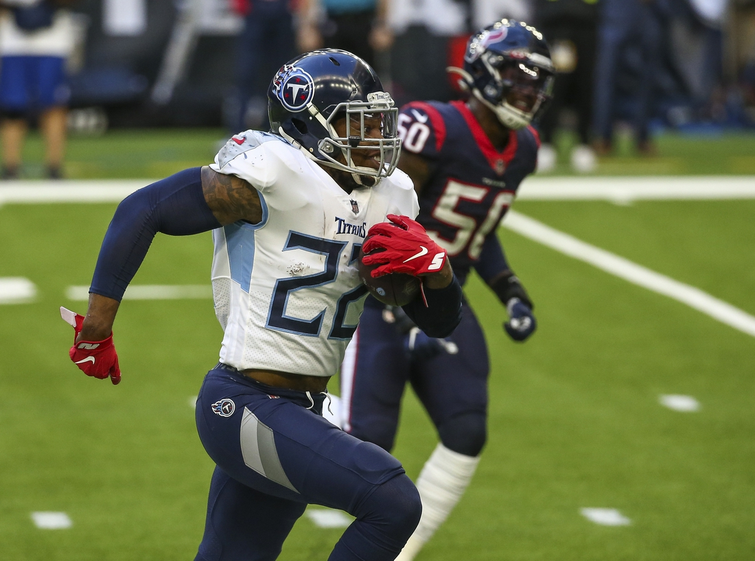 Jan 3, 2021; Houston, Texas, USA; Tennessee Titans running back Derrick Henry (22) runs the ball against the Houston Texans during the second quarter at NRG Stadium. Mandatory Credit: Troy Taormina-USA TODAY Sports