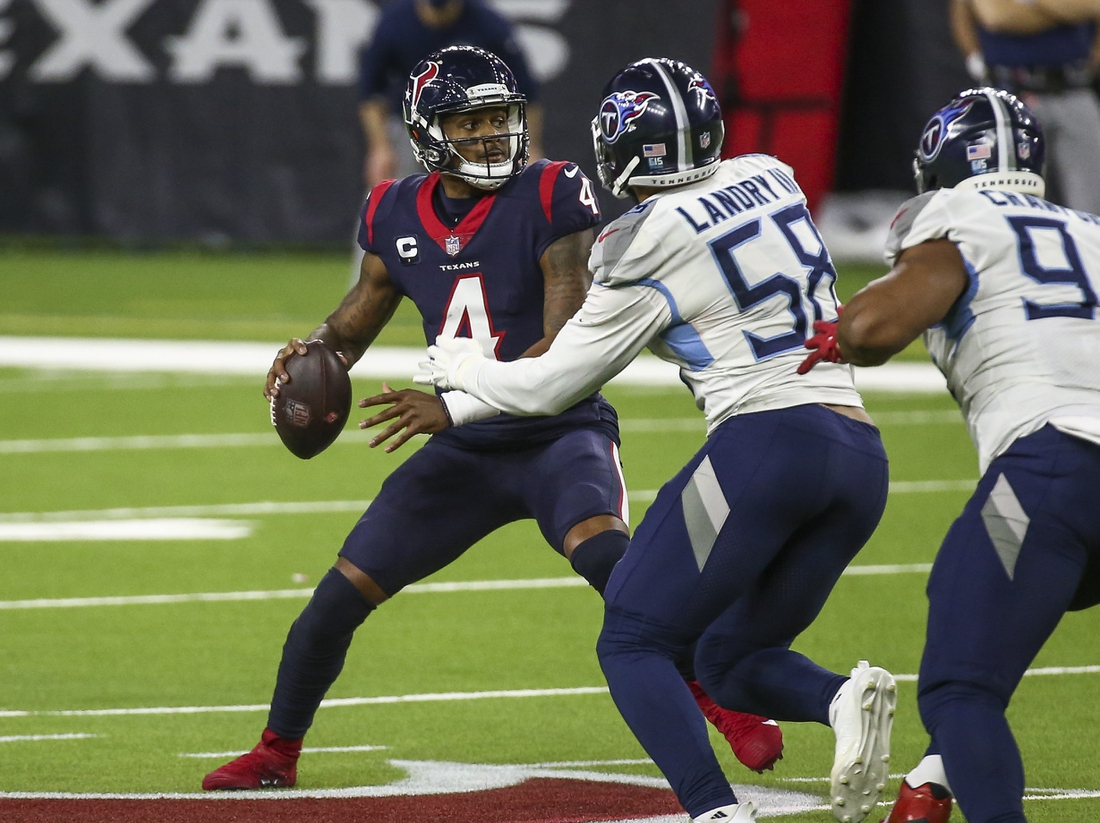 Jan 3, 2021; Houston, Texas, USA; Houston Texans quarterback Deshaun Watson (4) attempts a pass as Tennessee Titans outside linebacker Harold Landry (58) defends during the fourth quarter at NRG Stadium. Mandatory Credit: Troy Taormina-USA TODAY Sports