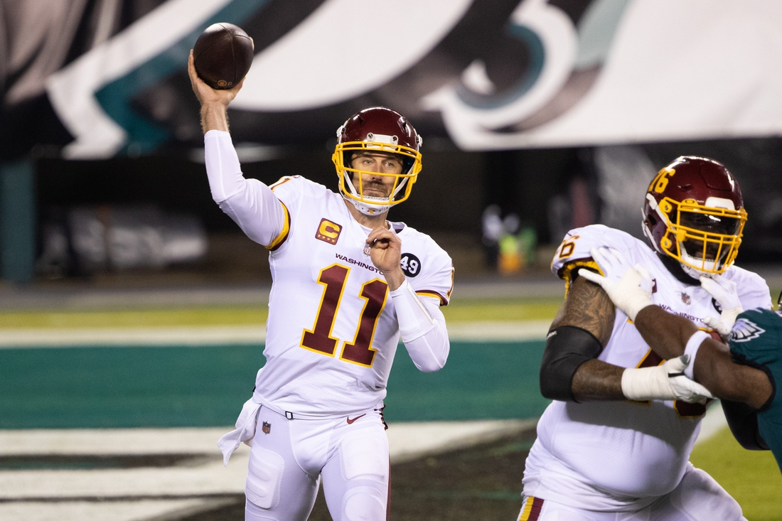 Jan 3, 2021; Philadelphia, Pennsylvania, USA; Washington Football Team quarterback Alex Smith (11) passes the ball against the Philadelphia Eagles during the first quarter at Lincoln Financial Field. Mandatory Credit: Bill Streicher-USA TODAY Sports