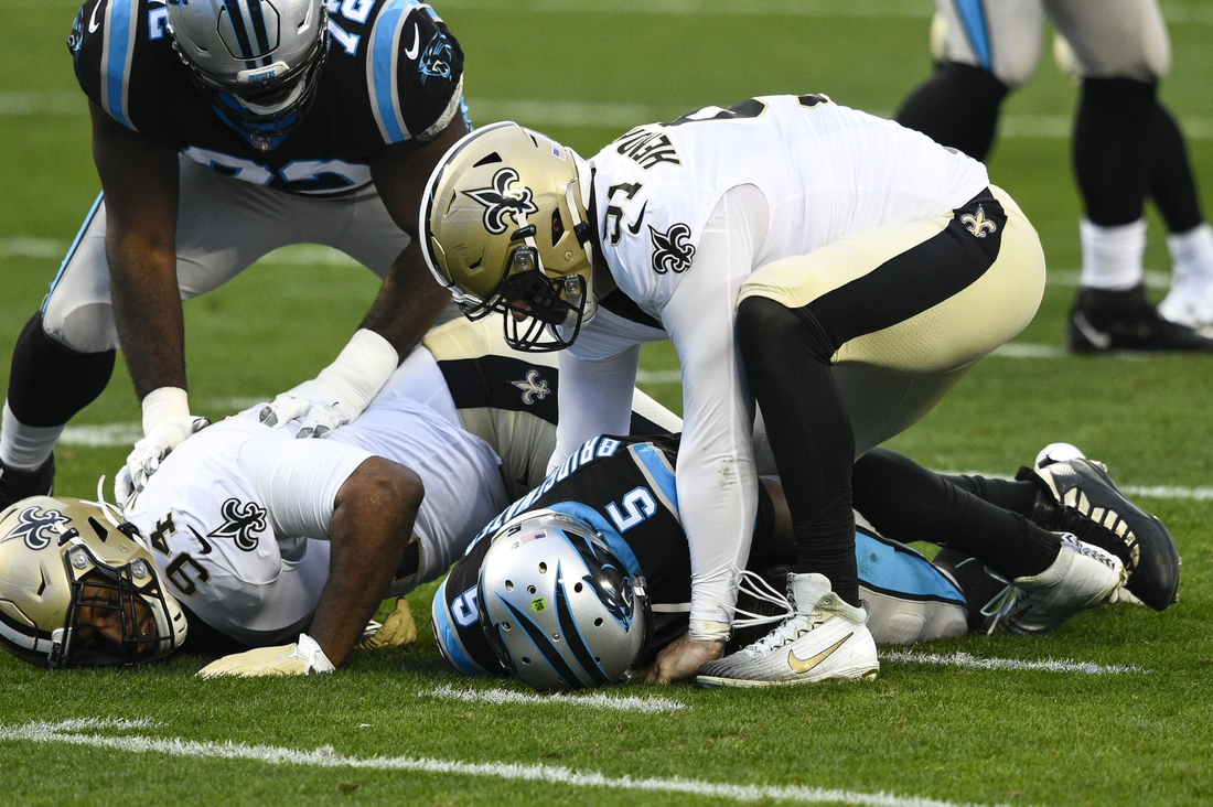 Jan 3, 2021; Charlotte, North Carolina, USA; Carolina Panthers quarterback Teddy Bridgewater (5) is sacked by New Orleans Saints defensive ends Cameron Jordan (94) and Trey Hendrickson (91) in the first quarter at Bank of America Stadium. Mandatory Credit: Bob Donnan-USA TODAY Sports