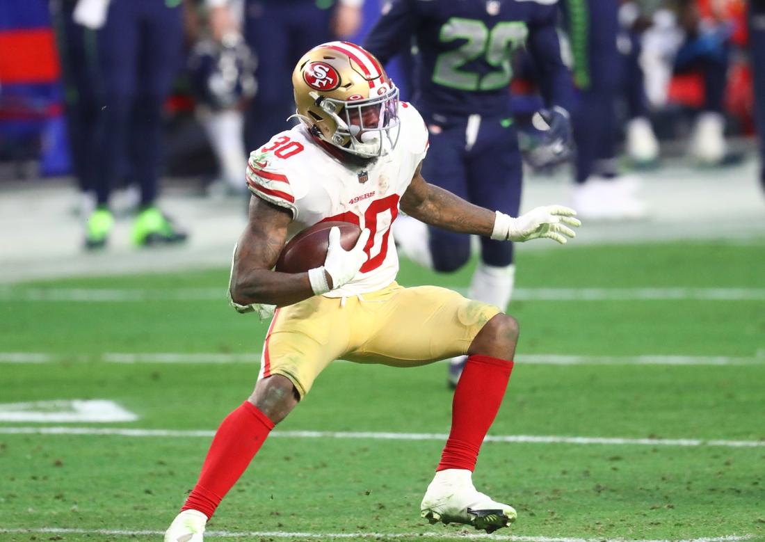 Jan 3, 2021; Glendale, Arizona, USA; San Francisco 49ers running back Jeff Wilson Jr. (30) against the Seattle Seahawks at State Farm Stadium. Mandatory Credit: Mark J. Rebilas-USA TODAY Sports