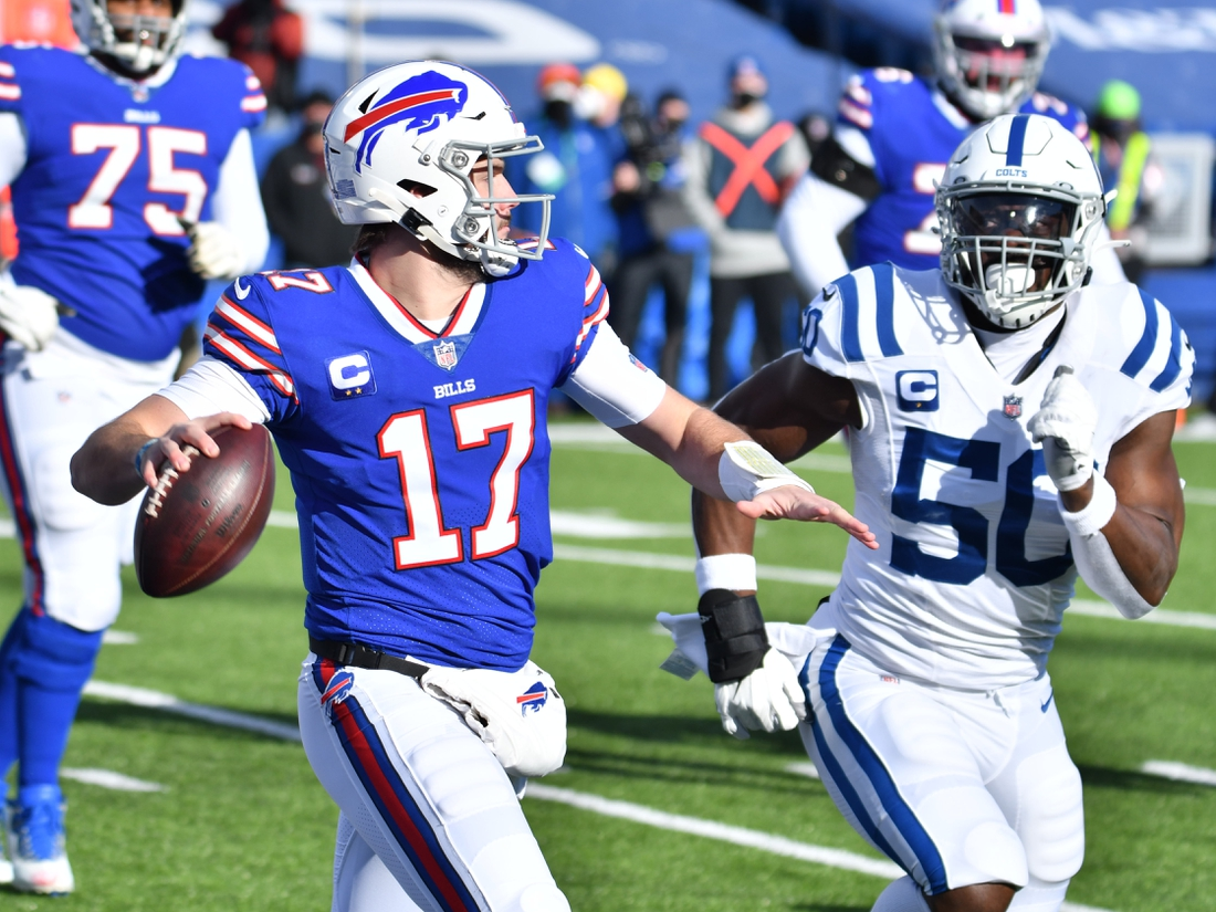 Jan 9, 2021; Orchard Park, New York, USA; Buffalo Bills quarterback Josh Allen (17) looks to throw a pass as Indianapolis Colts defensive end Justin Houston (50) applies pressure in the first quarter at Bills Stadium. Mandatory Credit: Mark Konezny-USA TODAY Sports