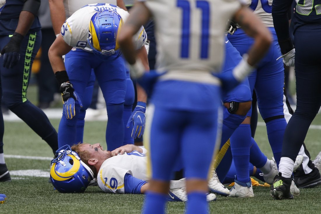 Jan 9, 2021; Seattle, Washington, USA; Los Angeles Rams quarterback John Wolford (9) lays on the ground after being injured during the first quarter against the Seattle Seahawks at Lumen Field. Mandatory Credit: Joe Nicholson-USA TODAY Sports