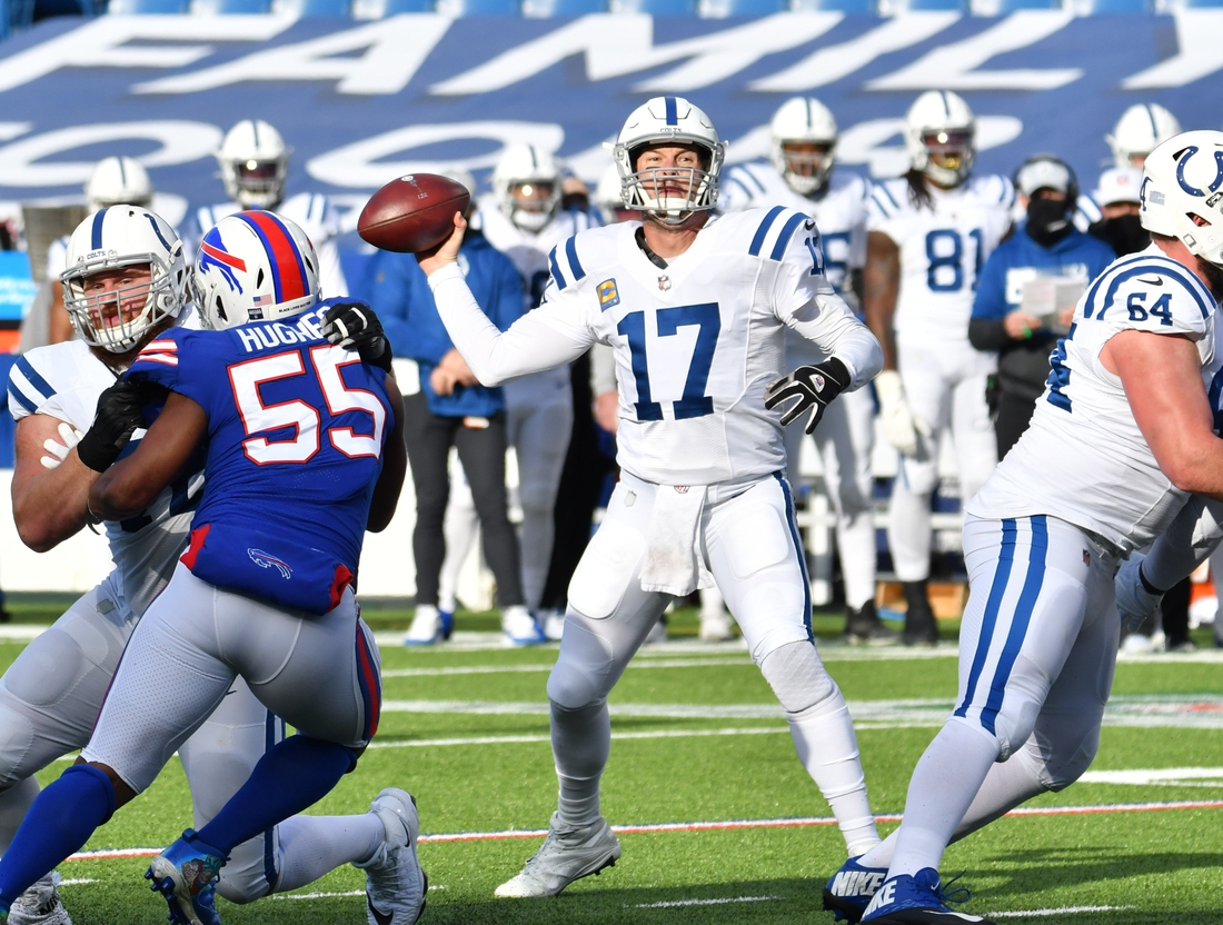 Jan 9, 2021; Orchard Park, New York, USA; Indianapolis Colts quarterback Philip Rivers (17) throws a pass as Buffalo Bills defensive end Jerry Hughes (55) rushes in the second quarter at Bills Stadium. Mandatory Credit: Mark Konezny-USA TODAY Sports