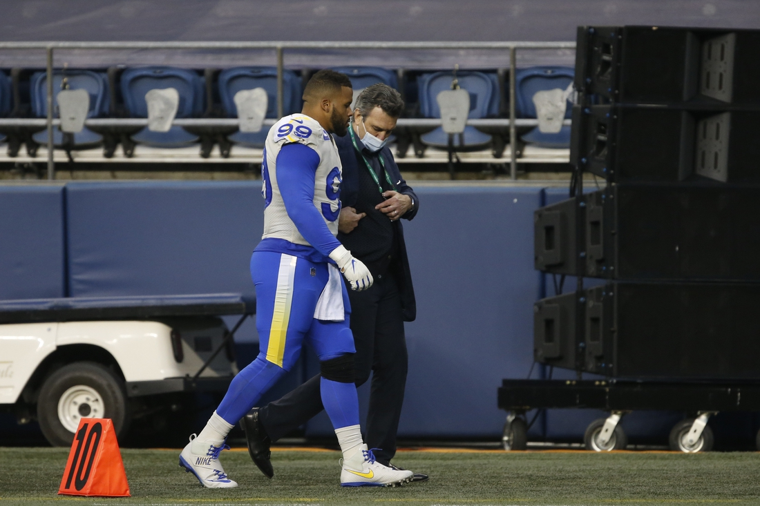 Jan 9, 2021; Seattle, Washington, USA; Los Angeles Rams defensive tackle Aaron Donald (99) walks off the field after an injury against the Seattle Seahawks during the third quarter at Lumen Field. Mandatory Credit: Joe Nicholson-USA TODAY Sports