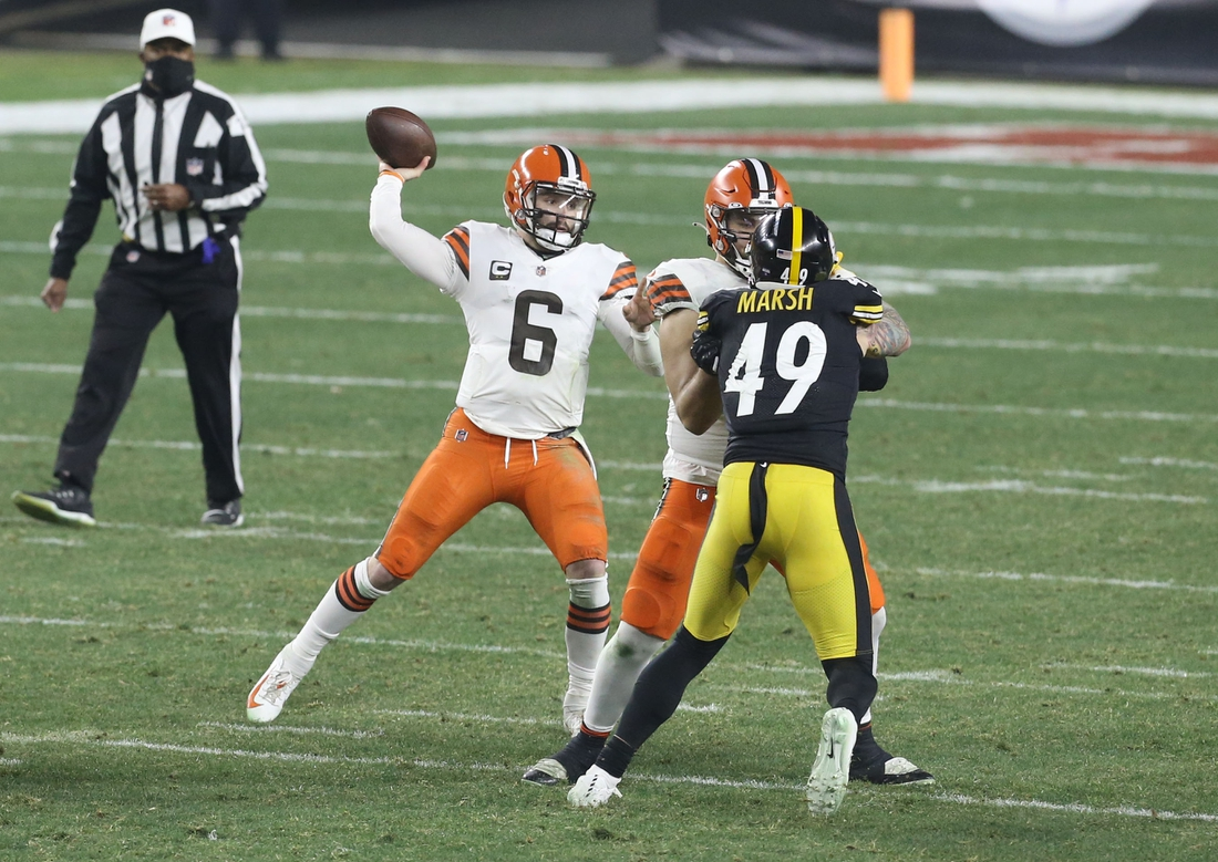 Jan 10, 2021; Pittsburgh, PA, USA; Cleveland Browns quarterback Baker Mayfield (6) throws a pass against the Pittsburgh Steelers in the second quarter of an AFC Wild Card playoff game at Heinz Field. Mandatory Credit: Charles LeClaire-USA TODAY Sports