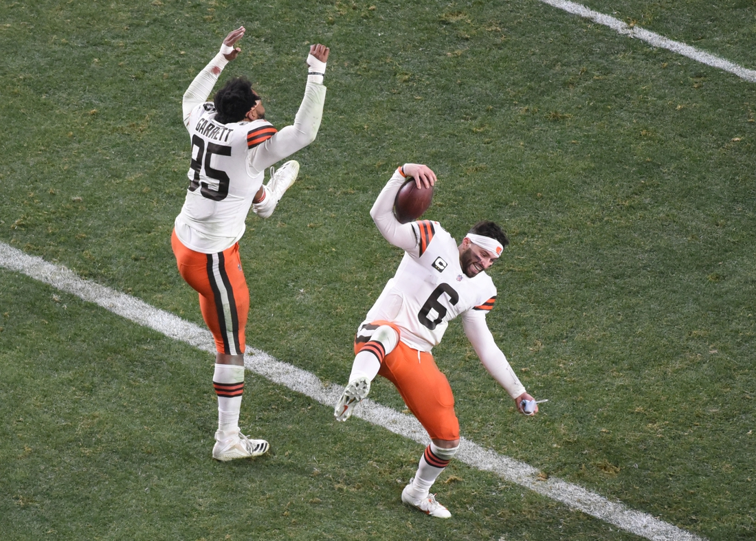 Jan 10, 2021; Pittsburgh, PA, USA; Cleveland Browns quarterback Baker Mayfield (6) and defensive end Myles Garrett (95) celebrate after the AFC Wild Card playoff game against the Pittsburgh Steelers at Heinz Field. Mandatory Credit: Philip G. Pavely-USA TODAY Sports