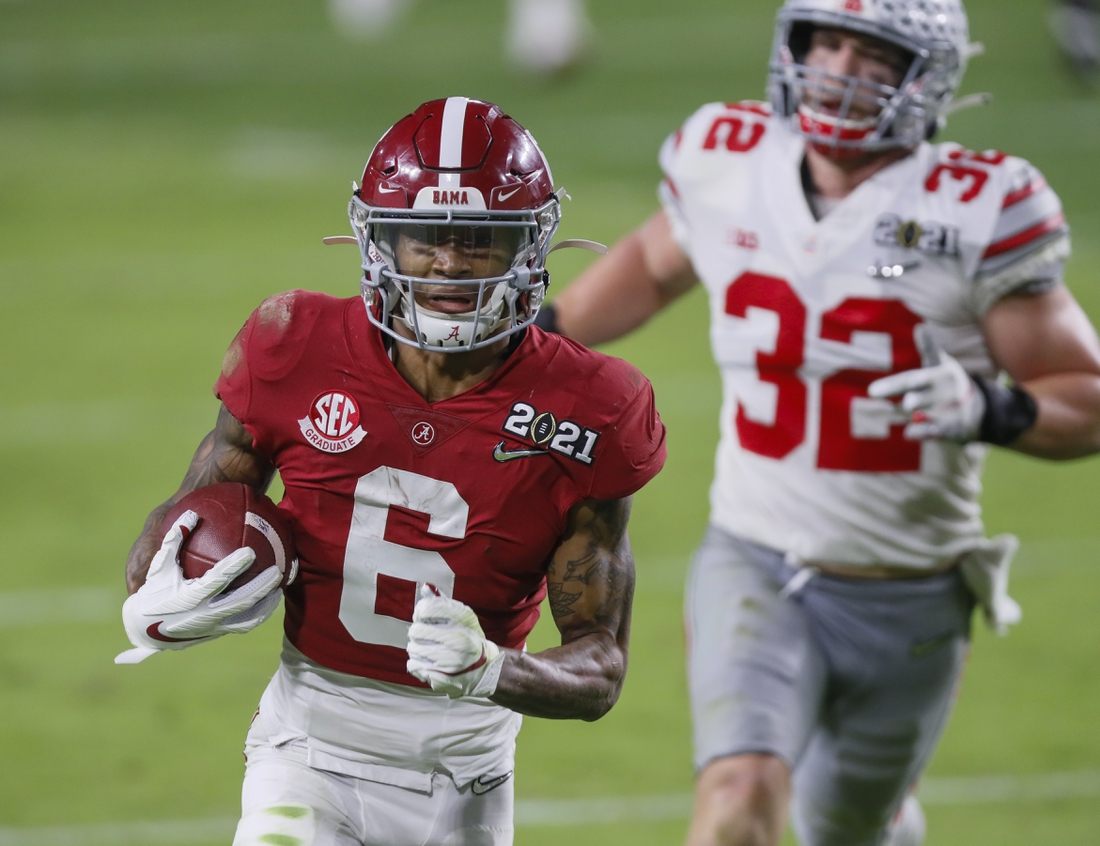 Jan. 11, 2021; Miami Gardens, Florida, USA; Alabama Crimson Tide wide receiver DeVonta Smith (6) catches a 42-yard touchdown behind Ohio State Buckeyes linebacker Tuf Borland (32) during the second quarter of the College Football Playoff National Championship at Hard Rock Stadium in Miami Gardens, Fla. Mandatory Credit: Kyle Robertson-USA TODAY Sports