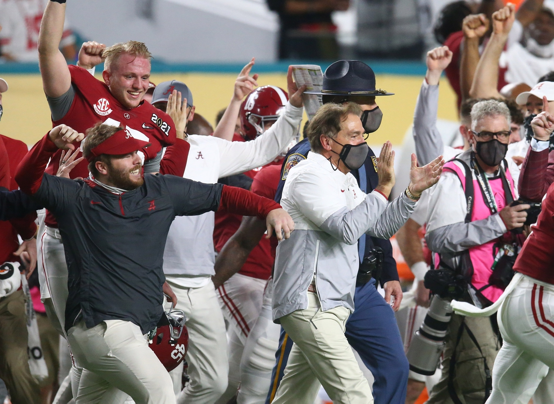 Jan 11, 2021; Miami Gardens, Florida, USA; Alabama Crimson Tide head coach Nick Saban celebrates after defeating the Ohio State Buckeyes in the 2021 College Football Playoff National Championship Game. Mandatory Credit: Mark J. Rebilas-USA TODAY Sports