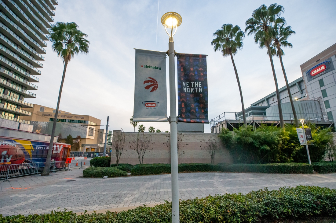 Jan 14, 2021; Tampa, Florida, USA;  A general view of the exterior of Amalie Arena as a Tampa Streetcar outfitted with Super Bowl LV advertising drives by before a game between the Toronto Raptors and Charlotte Hornets at Amalie Arena. Mandatory Credit: Mary Holt-USA TODAY Sports