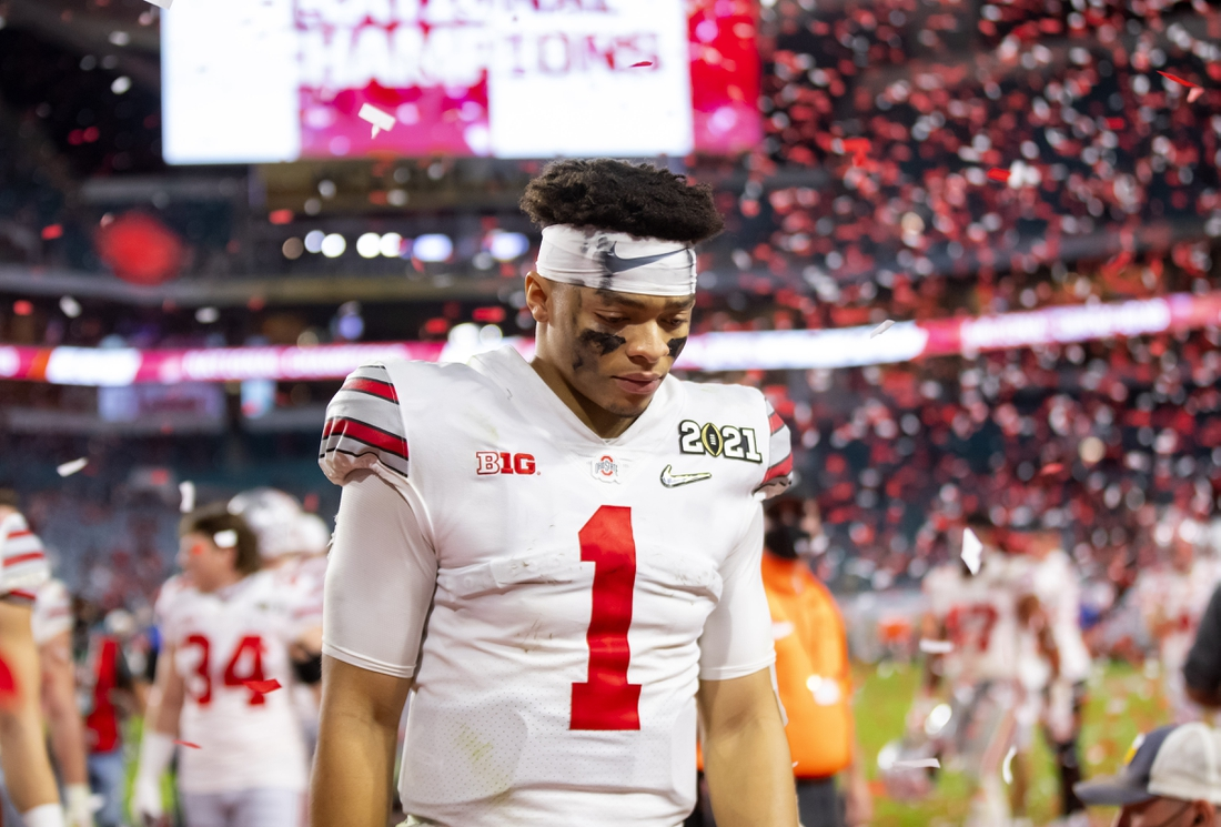 Jan 11, 2021; Miami Gardens, Florida, USA; Ohio State Buckeyes quarterback Justin Fields (1) reacts as he walks off the field after losing to the Alabama Crimson Tide in the 2021 CFP National Championship Game. Mandatory Credit: Mark J. Rebilas-USA TODAY Sports