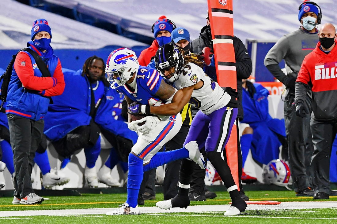 Jan 16, 2021; Orchard Park, New York, USA; Baltimore Ravens cornerback Tramon Williams (29) tackles Buffalo Bills wide receiver Stefon Diggs (14) during the second half of an AFC Divisional Round playoff game at Bills Stadium. Mandatory Credit: Rich Barnes-USA TODAY Sports