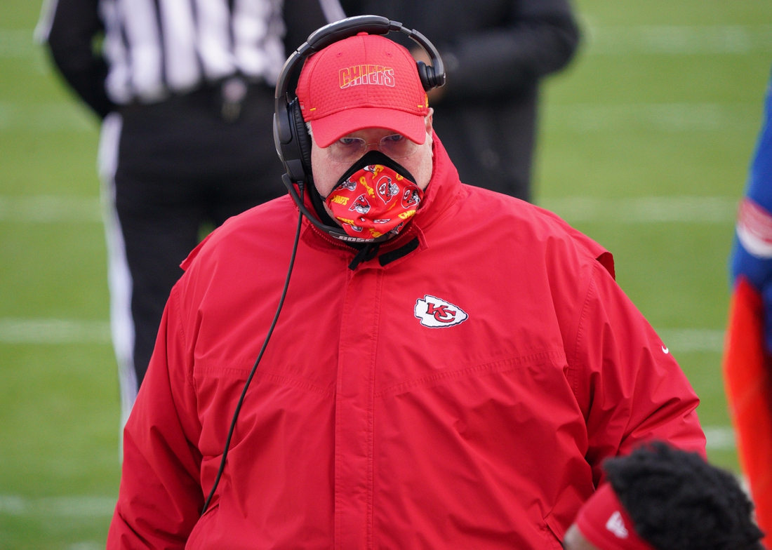 Jan 17, 2021; Kansas City, Missouri, USA; Kansas City Chiefs head coach Andy Reid speaks to players during the first half in the AFC Divisional Round playoff game at Arrowhead Stadium. Mandatory Credit: Denny Medley-USA TODAY Sports