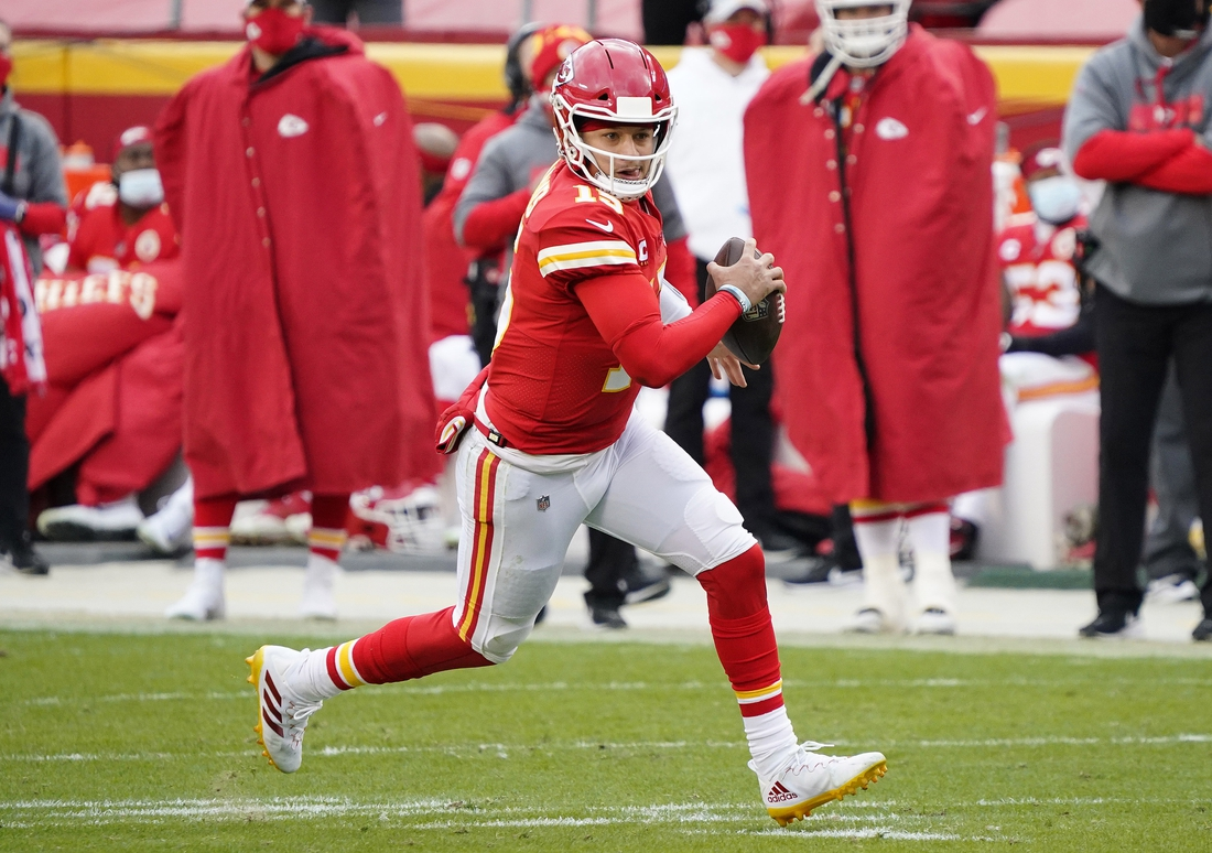 Jan 17, 2021; Kansas City, Missouri, USA; Kansas City Chiefs quarterback Patrick Mahomes (15) runs the ball against the Cleveland Browns during the first half in the AFC Divisional Round playoff game at Arrowhead Stadium. Mandatory Credit: Jay Biggerstaff-USA TODAY Sports