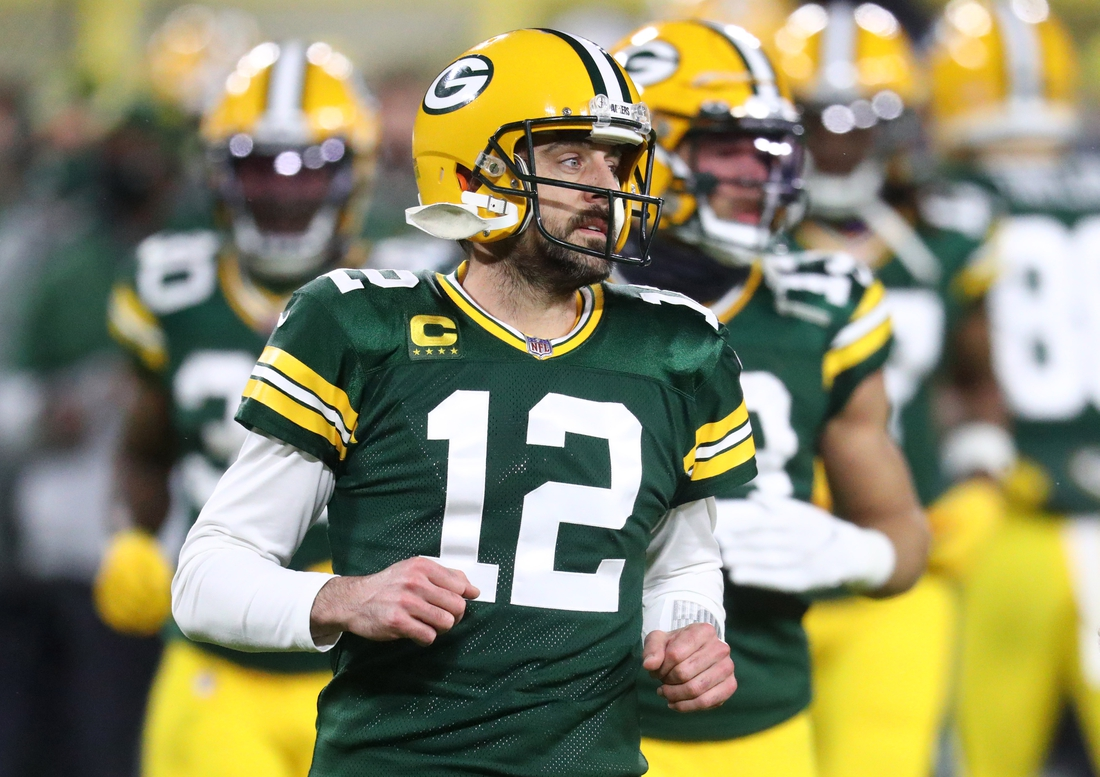 Jan 16, 2021; Green Bay, Wisconsin, USA; Green Bay Packers quarterback Aaron Rodgers (12) against the Los Angeles Rams during the NFC Divisional Round at Lambeau Field. Mandatory Credit: Mark J. Rebilas-USA TODAY Sports