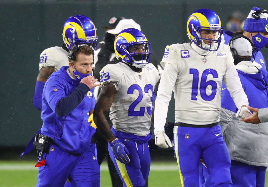 Jan 16, 2021; Green Bay, Wisconsin, USA; Los Angeles Rams head coach Sean McVay with running back Cam Akers (23) and quarterback Jared Goff (16) against Green Bay Packers during the NFC Divisional Round at Lambeau Field. Mandatory Credit: Mark J. Rebilas-USA TODAY Sports