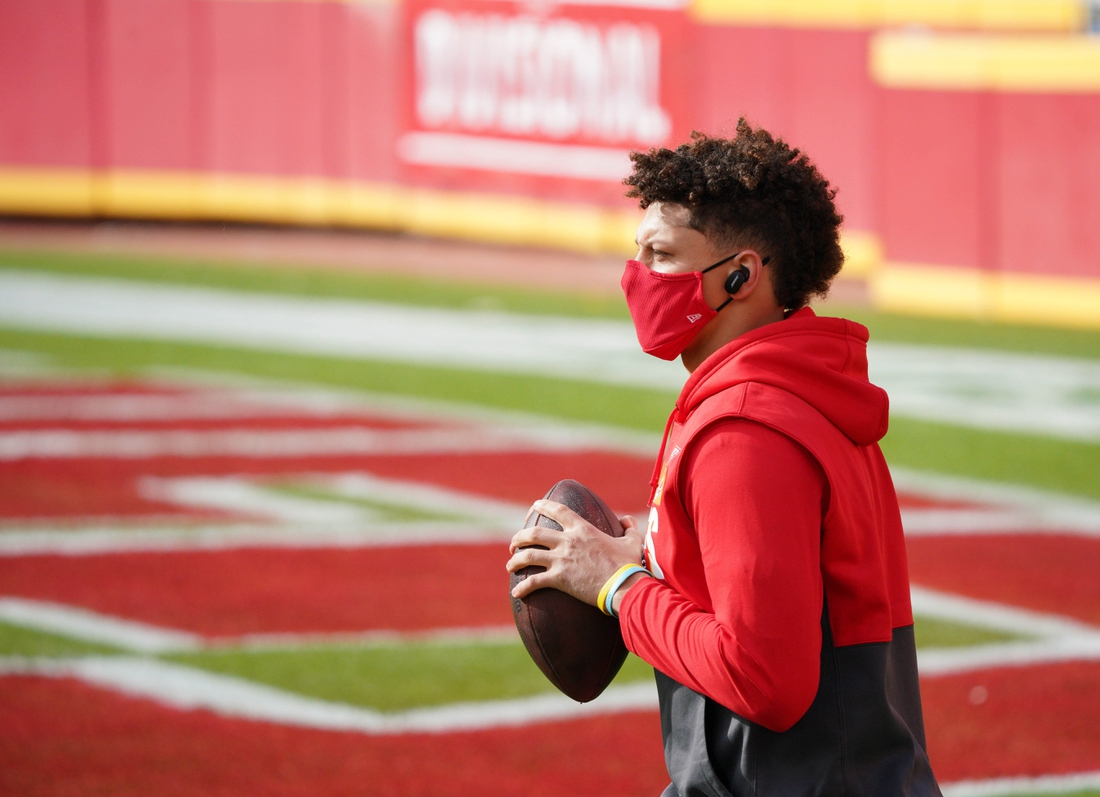 Jan 17, 2021; Kansas City, Missouri, USA; Kansas City Chiefs quarterback Patrick Mahomes (15) warms up before the AFC Divisional Round playoff game against the Cleveland Browns at Arrowhead Stadium. Mandatory Credit: Denny Medley-USA TODAY Sports