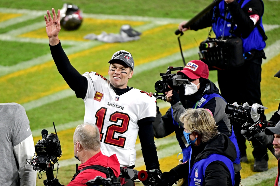 Jan 24, 2021; Green Bay, Wisconsin, USA; Tampa Bay Buccaneers quarterback Tom Brady (12) celebrates after beating the Green Bay Packers in the NFC Championship Game at Lambeau Field . Mandatory Credit: Benny Sieu-USA TODAY Sports
