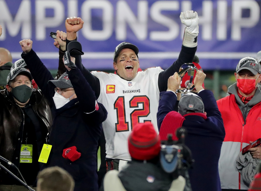 Jan 24, 2021, Green Bay, WI, USA; Tampa Bay Buccaneers quarterback Tom Brady (12) exalts during the presentation off the George Halas Trophy after  their NFC Championship game Sunday, January 24, 2021 at Lambeau Field in Green Bay, Wis. The Tampa Bay Buccaneers beat the Green Bay Packers 31-26. Mandatory credit: Mark Hoffman / Milwaukee Journal Sentinel via USA TODAY NETWORK