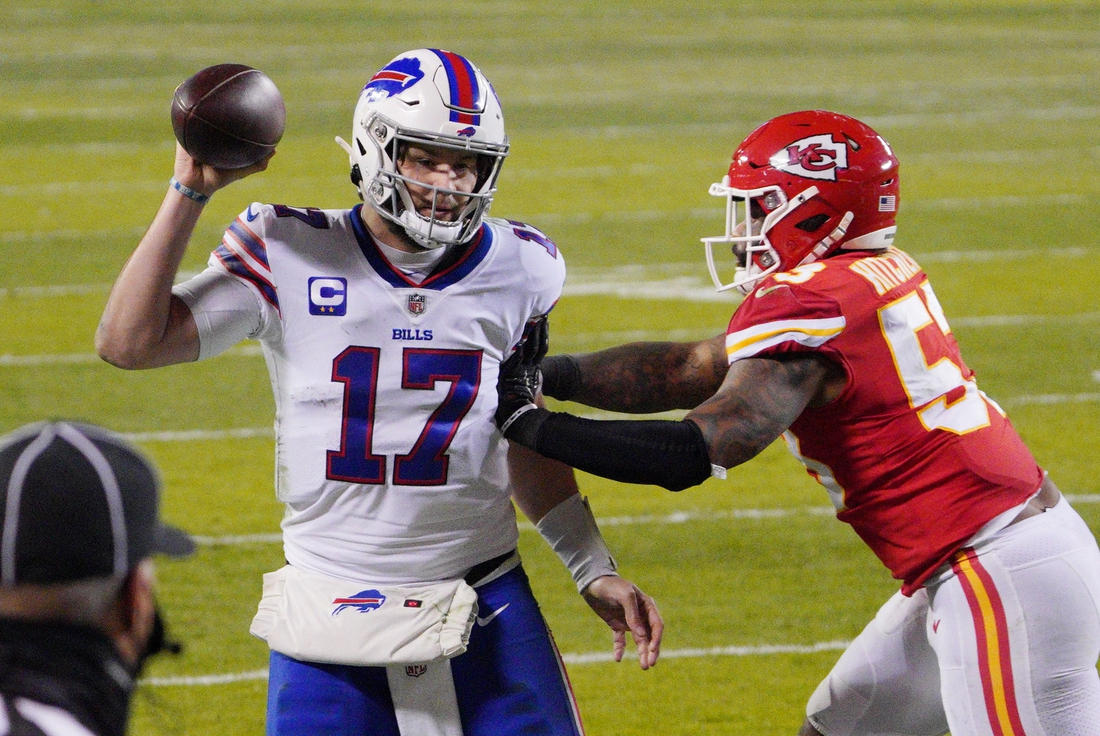 Jan 24, 2021; Kansas City, MO, USA; Buffalo Bills quarterback Josh Allen (17) throws the ball away before being pushed out of bounds by Kansas City Chiefs middle linebacker Anthony Hitchens (53) during the second quarter in the AFC Championship Game at Arrowhead Stadium. Mandatory Credit: Denny Medley-USA TODAY Sports