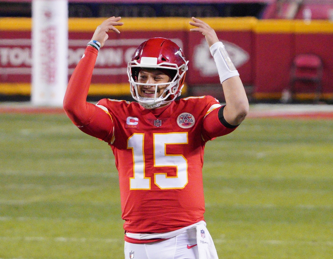 Jan 24, 2021; Kansas City, MO, USA; Kansas City Chiefs quarterback Patrick Mahomes (15) celebrates during the fourth quarter in the AFC Championship Game against the Buffalo Bills at Arrowhead Stadium. Mandatory Credit: Denny Medley-USA TODAY Sports