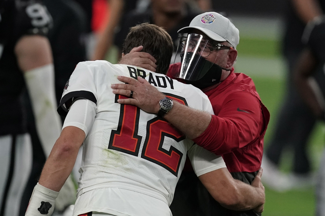 Oct 25, 2020; Paradise, Nevada, USA; Tampa Bay Buccaneers quarterback Tom Brady (12) and coach Bruce Arians embrace after the game against the Las Vegas Raiders at Allegiant Stadium. The Buccaneers defeated the Raiders 45-20. Mandatory Credit: Kirby Lee-USA TODAY Sports