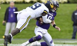Sep 29, 2018; Evanston, IL, USA; Michigan Wolverines defender Kwity Paye (left) sacks Northwestern Wildcats quarterback Clayton Thorson (right) in the first half at Ryan Field. Mandatory Credit: Quinn Harris-USA TODAY Sports