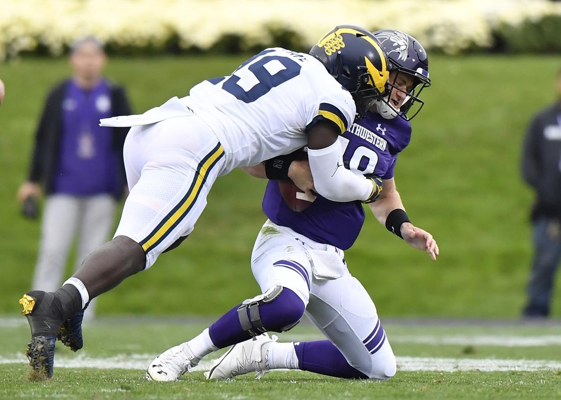 Sep 29, 2018; Evanston, IL, USA; Michigan Wolverines defender Kwity Paye (left) sacks Northwestern Wildcats quarterback Clayton Thorson (right) in the first half at Ryan Field. Mandatory Credit: Quinn Harris-USA TODAY Sports