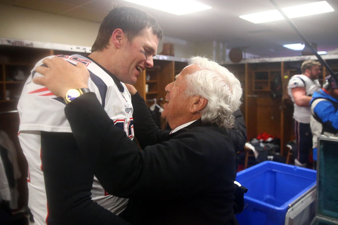 Jan 20, 2019; Kansas City, MO, USA; New England Patriots quarterback Tom Brady (12) greets owner Robert Kraft in the locker room as they celebrate their win over the Kansas City Chiefs during overtime in the AFC Championship game at Arrowhead Stadium. Mandatory Credit: Mark Rebilas-USA TODAY Sports