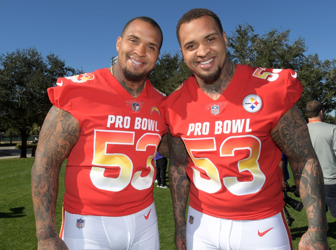 Jan 25, 2019; Kissimmee, FL, USA; Twin brothers and centers Mike Pouncey of the Los Angeles Chargers (left) and Maurkice Pouncey of the Pittsburgh Steelers pose during AFC practice at ESPN Wide World of Sports Complex. Mandatory Credit: Kirby Lee-USA TODAY Sports