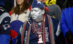 Jan 4, 2020; Foxborough, Massachusetts, USA;  A New England Patriots fan watches the end of a game against the Tennessee Titans at Gillette Stadium. Mandatory Credit: Greg M. Cooper-USA TODAY Sports