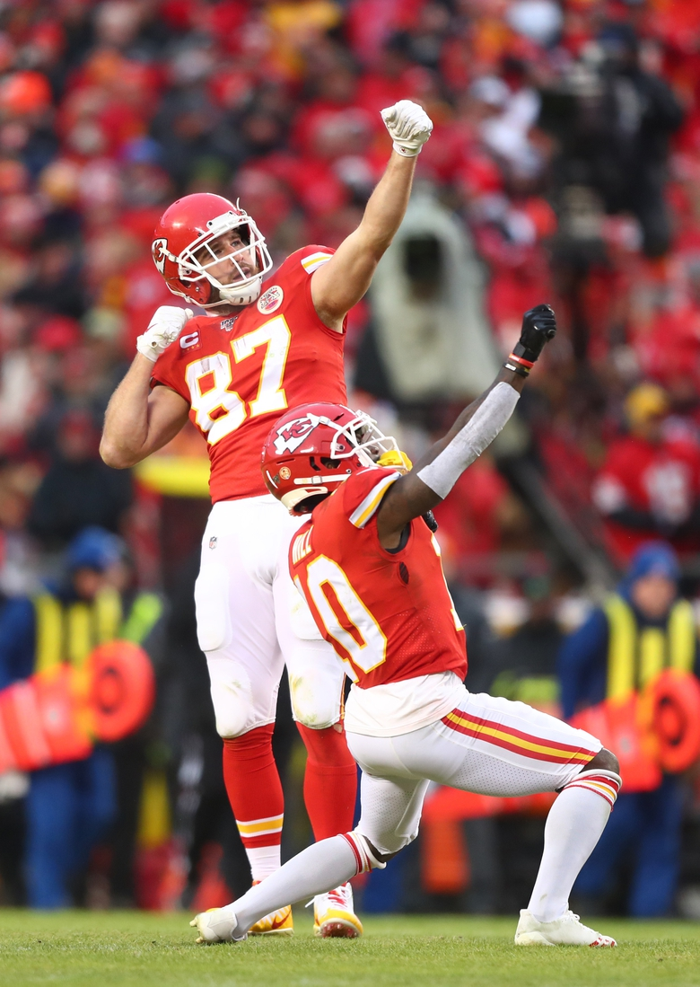 Jan 12, 2020; Kansas City, Missouri, USA; Kansas City Chiefs tight end Travis Kelce (87) celebrates with wide receiver Tyreek Hill (10) against the Houston Texans in the AFC Divisional Round playoff football game at Arrowhead Stadium. Mandatory Credit: Mark J. Rebilas-USA TODAY Sports