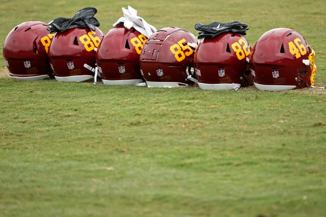 Aug 19, 2020; Ashburn, Virginia, USA; Helmets of Washington Football Team players rest on the field on day twenty-two of training camp at Inova Sports Performance Center in Ashburn, Virginia. Mandatory Credit: Geoff Burke-USA TODAY Sports