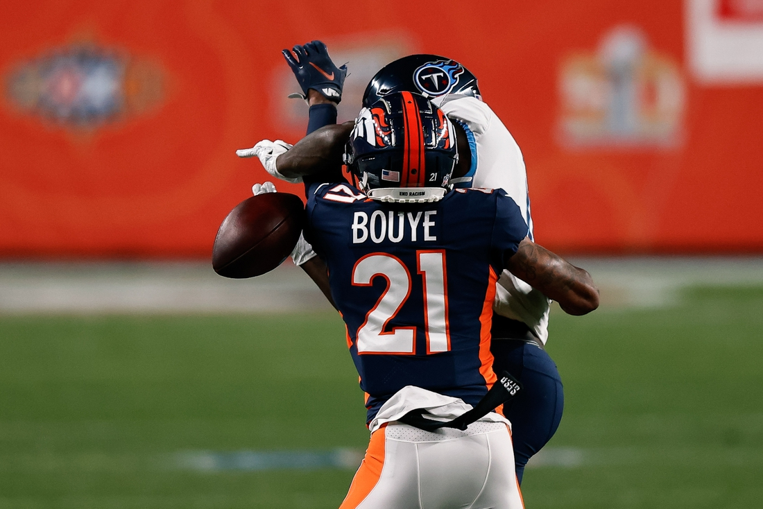 Sep 14, 2020; Denver, Colorado, USA; Denver Broncos cornerback A.J. Bouye (21) breaks up a pass intended for Tennessee Titans wide receiver A.J. Brown (11) in the first quarter at Empower Field at Mile High. Mandatory Credit: Isaiah J. Downing-USA TODAY Sports
