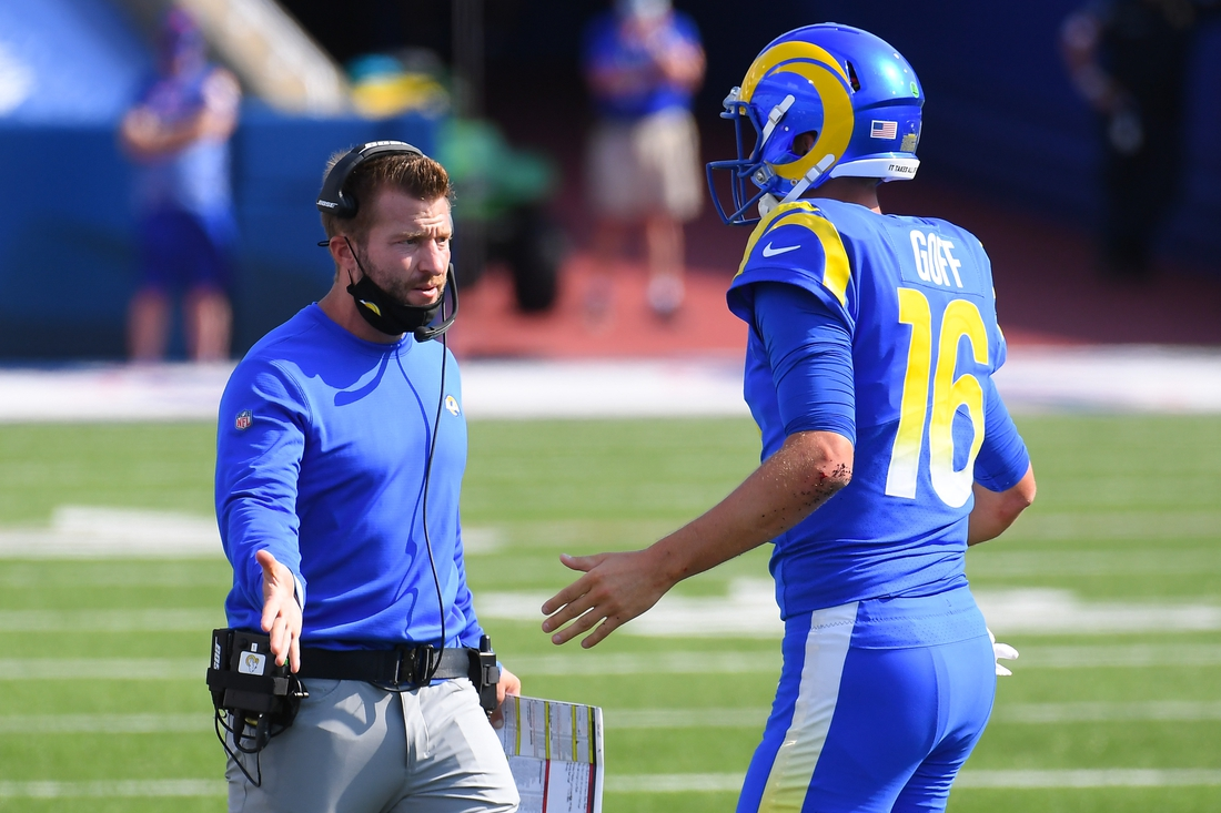 Sep 27, 2020; Orchard Park, New York, USA; Los Angeles Rams head coach Sean McVay greets quarterback Jared Goff (16) following his touchdown run against the Buffalo Bills during the third quarter at Bills Stadium. Mandatory Credit: Rich Barnes-USA TODAY Sports