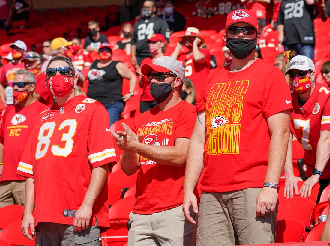 Oct 11, 2020; Kansas City, Missouri, USA; Masked Kansas City Chiefs fans show their support during the game against the Las Vegas Raiders at Arrowhead Stadium. Mandatory Credit: Denny Medley-USA TODAY Sports